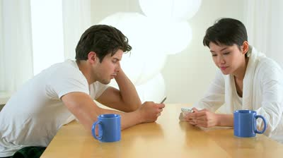 Courtesy of Google Image search: Couple checking out their smart phones.