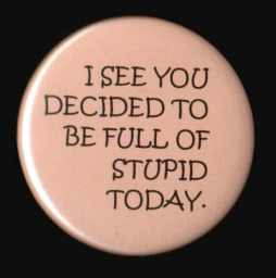 President Obama's favorite button to wear while in the company of his staff..  Courtesy of Google Image search.