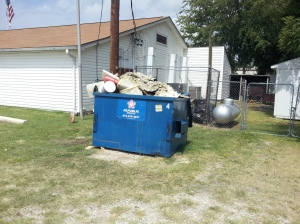 American Legion Post 310 Gun Barrel City Texas' Dumpster facing residential homes.