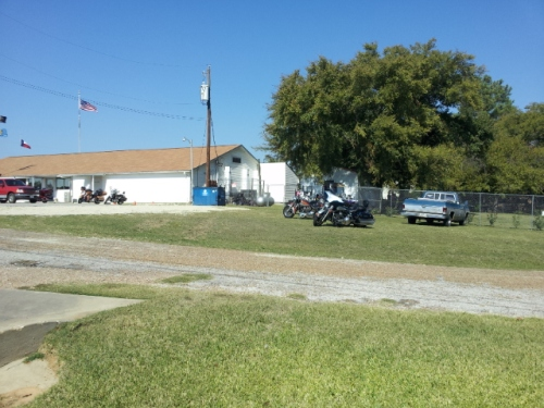 More of the same, the same day but latter in day. Note:  additional bikes parked along side of Amercian Legion Building.  Copyright 2014 John J. Rigo